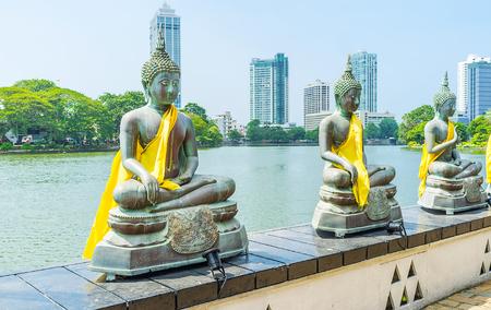 pieris: The numerous statues of Lord Buddha in Seema Malaka Temple are the main landmarks on Beira lake, Colombo, Sri Lanka.