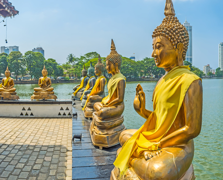 pieris: Seema Malaka Temple on Beira lake is picturesque and spiritual site, where Buddhist worshipers find harmony among the golden statues on the bank, Colombo, Sri Lanka.