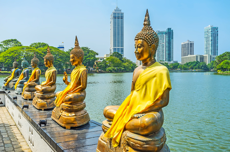 Beira lake is the perfect place to relax in shade of trees, enjoy the fresh breeze and visit Seema Malaka Temple with its scenic golden statues of Buddha, Colombo, Sri Lanka.