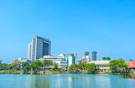 entertainment center: Nowadays Beira lake became popular tourist location, here locate such landmarks as Seema Malaka Temple, island Gangaramaya park and also shopping quarters on lakes banks, Colombo, Sri Lanka. Stock Photo