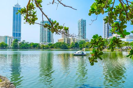 Beira lake offers many attractions - trips on swan catamarans, relax in Gangaramaya island park or visit Seema Malaka lake temple, Colombo, Sri lanka. Stock Photo