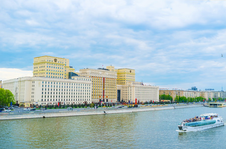 MOSCOW, RUSSIA - MAY 11, 2015: Boat trips are very popular in Moscow due to beautiful edifices on embankments, on May 11 in Moscow, Russia