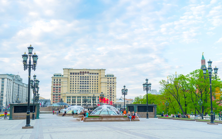 MOSCOW, RUSSIA - MAY 11, 2015: The view on raw of fountains on Manezhnaya Square with Four Seasons Hotel on background, on May 11 in Moscow Editorial