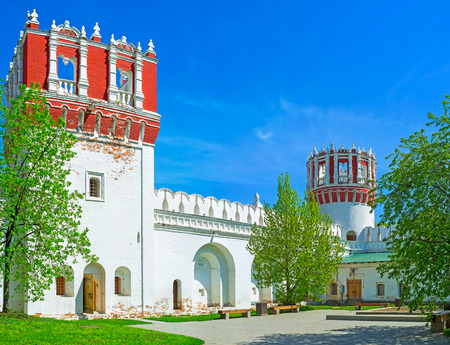 The inner courtyard of Novodevichy Convent with its unusual Nikolskaya and Tsaritsyna towers, Moscow, Russia