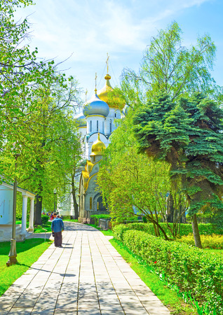 MOSCOW, RUSSIA - MAY 08, 2015: Smolensky Cathedral surrounded with lush greenery is a very popular church among locals, on May 08 in Moscow