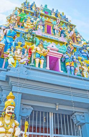 Details of Gopuram tower of Kali Amman Temple in Negombo, the sculptures of Hindu deities, painted in bright colors, Sri Lanka.