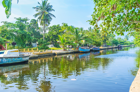 city park boat house: The Hamiltons Canal, stretching between Colombo and Negombo is surrounded by lush tropic gardens, palm plantations, villages, and forests, Wattala suburb, Sri Lanka.