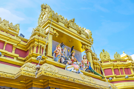 The scultures of Hindu deities above the gate to the Sri Muthu Vinayakar Swamy Kovil in Sea street of Pettah district, Colombo, Sri Lanka.