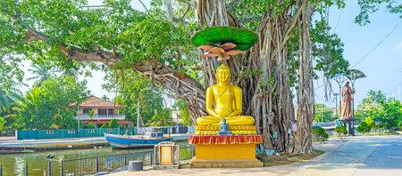 city park boat house: The golden statue of Meditating Lord Buddha of Sri Gangathilaka Purana Viharaya Temple on the bank of Hamiltons Canal in Wattala suburb of Colombo, Sri Lanka. Editorial
