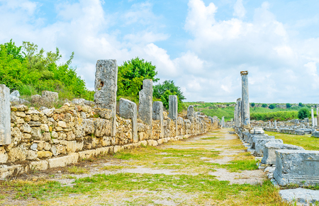 colonnaded: The colonnaded shopping street served as shopping zone with the water canal in the middle, Perge, Antalya, Turkey. Stock Photo