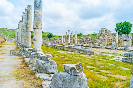 colonnaded: The view of ancient colonnaded street, former trade center of the city, decorated with slwnder marble columns, Perge, Antalya, Turkey.