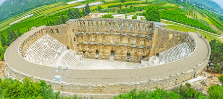 Aerial view of Aspendos amphitheater, located in the valley, that nowadays became the agriculture district of Serik, Turkey. 版權商用圖片 - 83941258