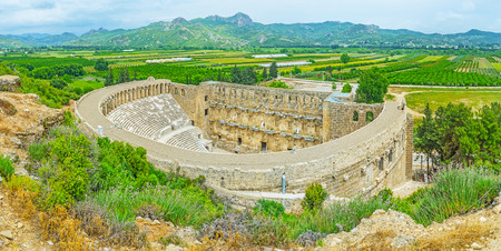 Aspendos archaeological site is the perfect place to enjoy the ancient landmarks and scenic landscapes of Serik agriculture lands, Turkey. Stock Photo