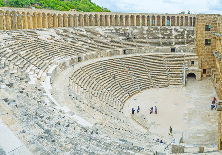 ASPENDOS, TURKEY - MAY 8, 2017: The stone scene and galleries of Aspendos amphitheater, the popular tourist landmark in Antalya province, on May 8 in Aspendos.