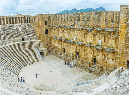 ASPENDOS, TURKEY - MAY 8, 2017: The archaeological zone of Aspendos is famous for well preserved amphitheater, the place of great historic and cultural interest, on May 8 in Aspendos.