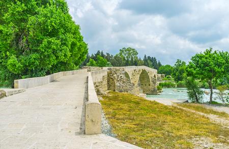 The zigzag road on the Eurymedon bridge, the notable medieval landmark of Seljuq era, Aspendos, Turkey.