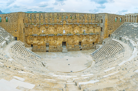 The great example of the ancient architecture in Pamphylian city of Aspendos - the giant stone amphitheater, Turkey. Stock Photo