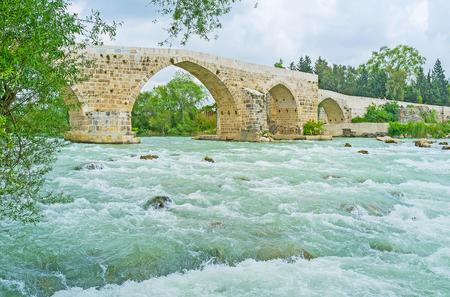 The medieval Seljuq bridge, built on the site of the late Roman bridge over the Eurymedon river, next to Aspendos, Turkey.