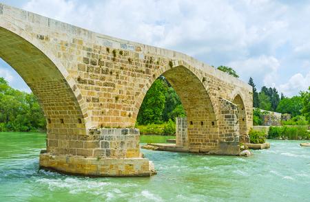 The stone zigzag Eurymedon Bridge over the same named river is the Roman era bridge, later rebuilt by Seljuqs, Aspendos, Turkey.