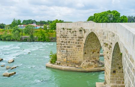 Koprupazar Koprusu - the Turkish name of the medieval Seljuq bridge, that was rebuilt after the Roman era Eurymedon Bridge, Aspendos, Turkey.