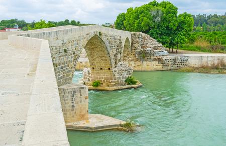 The unique zigzag construction of the rebuilt ancient Roman Eurymedon Bridge, Aspendos, Turkey.