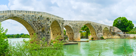 The zigzag arch bridge over the Eurymedon river, located next to the ancient Aspendos, was built by Romans, and later rebuilt by Seljuks, Turkey.