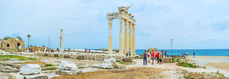 SIDE, TURKEY - MAY 8, 2017: Panorama of the coastline with the ruins of Apollos Temple, located in the archaeological site of resort, on May 8 in Side.