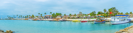 SIDE, TURKEY - MAY 8, 2017: Panorama of Mediterranean resort with boats and yachts in port, lovely cafes, restaurants and tourist stores along the seaside promenade, on May 8 in Side. Editorial