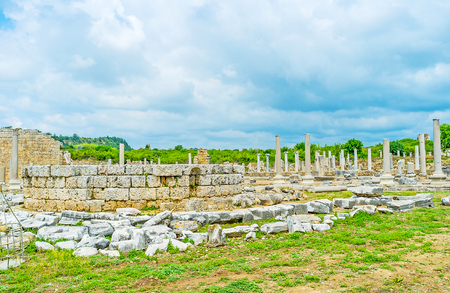 The stone altar among the ruins of ancient Tyche Temple, preserved in Perge archaeological zone, Antalya, Turkey. Stock Photo