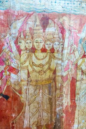 BATTALA, SRI LANKA - DECEMBER 2, 2016: The fresco of six-headed deity Murugan on the wall of Image House in Yudaganawa temple, on December 2 in Battala