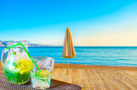 The best way to relax, watching the beach on Red sea, is to drink a glass of fresh mojito in coastal bar of Eilat, Israel.