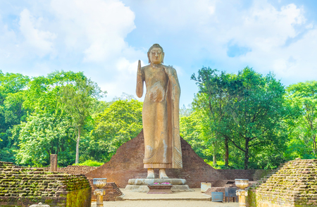 Maligawila Buddha statue is a holy place among locals and a popular tourist attraction in Sri Lanka