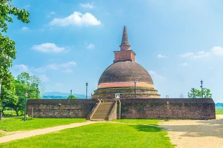 The Dematamal vihara boasts beautiful medieval dagoba, surrounded with trees and paddy fields, Okkampitiya, Sri Lanka Stock Photo