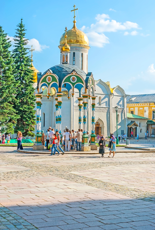 SERGIYEV POSAD, RUSSIA - JUNE 29, 2013: The central square of St Sergius Lavra with the Holy water fountain in scenic pavilion and Trinity Cathedral on background, on June 29 in Sergiyev Posad. Editorial