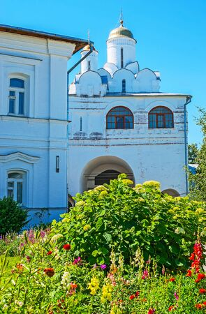 The view through the greenery on the Annunciation gate church of Suzdal Intercession Monastery, Russia. Stock Photo
