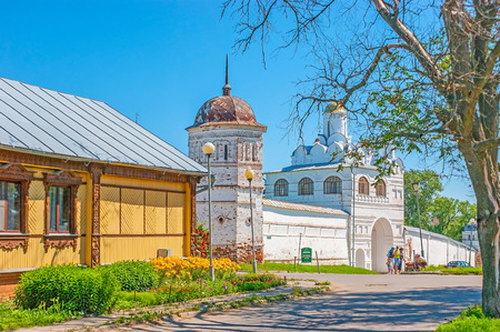 SUZDAL, RUSSIA - JULY 1, 2013: The walk along the streeet with a view on the fortress wall, tower, Main Gate and Annunciation Gate church of Intercession Monastery, on July 1 in Suzdal. Editorial
