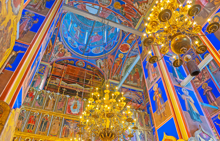 SUZDAL, RUSSIA - JULY 1, 2013: Interior of Nativity Cathedral of Kremlin, it boasts colored frescoes, golden chandeliers and masterpiece iconostasis, on July 1 in Suzdal.