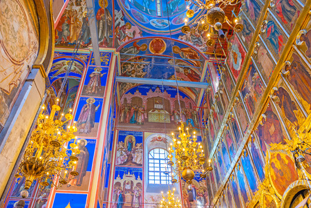 SUZDAL, RUSSIA - JULY 1, 2013: The bright colors of interior of Nativity Cathedral in Kremlin, all the icons are surrounded with golden patterns, on July 1 in Suzdal.