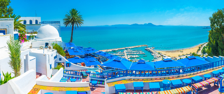 Sidi Bou Said boasts luxury restaurants and amazing viewpoints, overlooking its beaches, port and Cap Bon, seen on horizon, Tunisia.