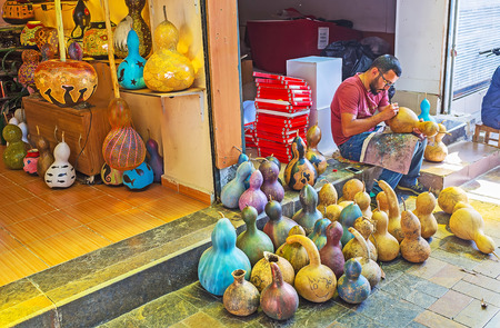 lamp shade: ANTALYA, TURKEY - MAY 12, 2017: The craftsman creates the shades and vases of dry pumpkins shells at his workshop, located in Old Bazaar, on May 12 in Antalya. Editorial
