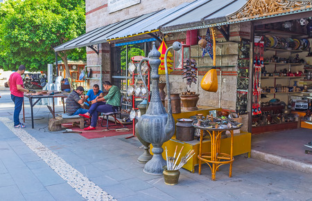 ANTALYA, TURKEY - MAY 12, 2017: The metalwork market is the interesting tourist attractions with wide range of souvenirs, traditional Eastern goods and oportunity to watch the masters at work at their workshops, on May 12 in Antalya. Editorial