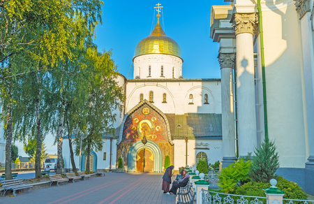 POCHAYIV, UKRAINE - AUGUST 29, 2017: The view on beautiful frontage of Holy Trinity Cathedral of Pochayiv Lavra, on August 29 in Pochayiv.