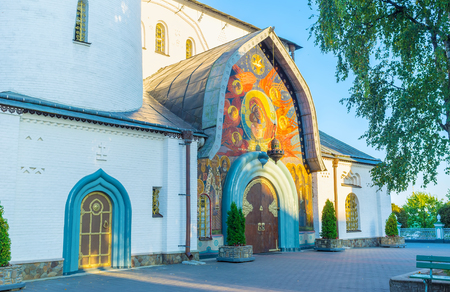 The Holy Trinity Cathedral of Pochayiv Lavra boasts beautiful mosaic frontage with old styled wooden doors, Ukraine Reklamní fotografie