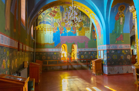 POCHAYIV, UKRAINE - AUGUST 29, 2017: Beautiful frescoes of Holy Trinity Cathedral painted in old russia style, depict Saints, martyrs, reverends and scenes from Holy Bible, on August 29 in Pochayiv. Editorial