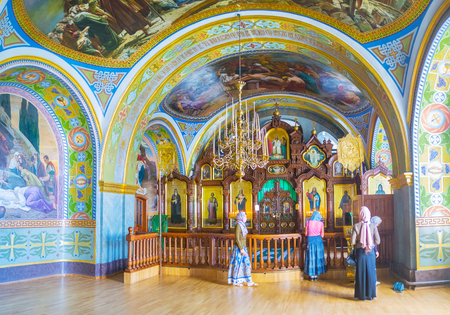 POCHAYIV, UKRAINE - AUGUST 30, 2017: The beautiful wooden carved iconostasis of St Job Church in Pochayiv Lavra complex, on August 30 in Pochayiv. Editorial