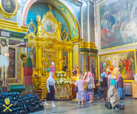 POCHAYIV, UKRAINE - AUGUST 30, 2017: Numerous pilgrims visit Pochayev Lavra to pray and bow before icon of Virgin Mary, on August 30 in Pochayiv.