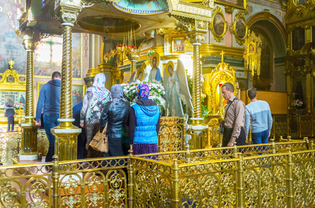 POCHAYIV, UKRAINE - AUGUST 30, 2017: The altar with icon of Dormition of Virgin Mary is one of the most holiest shrines in Pochayev Lavra complex, on August 30 in Pochayiv. Editorial