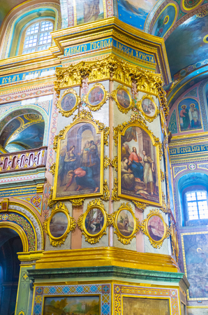 POCHAYIV, UKRAINE - AUGUST 30, 2017: Holy Dormition Cathedral is richly decorated with colorful frescoes and numerous icons in gilded frames, on August 30 in Pochayiv. Editorial