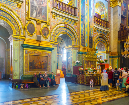 POCHAYIV, UKRAINE - AUGUST 30, 2017: The prayer hall of Dormition Cathedral of Pochaev Lavra with queue of parishioners to holy shrine,  on August 30 in Pochayiv.