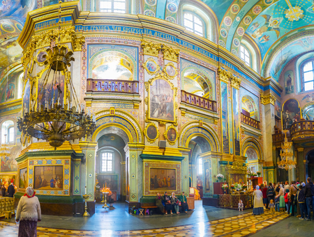 POCHAYIV, UKRAINE - AUGUST 30, 2017: Panorama of interior of Dormition Cathedral of Pochaev Lavra with a queue to the shrine of the complex,  on August 30 in Pochayiv.